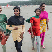 The surfer girls walking on the beach of Cox's Bazar, Bangladesh