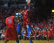 "Ole Miss forward Terrance Henry (1) shoots over Kentucky's Darius Miller (1) at the C.M. ""Tad"" Smith Coliseum in Oxford, Miss. on Tuesday, February 1, 2011. Ole Miss won 71-69."