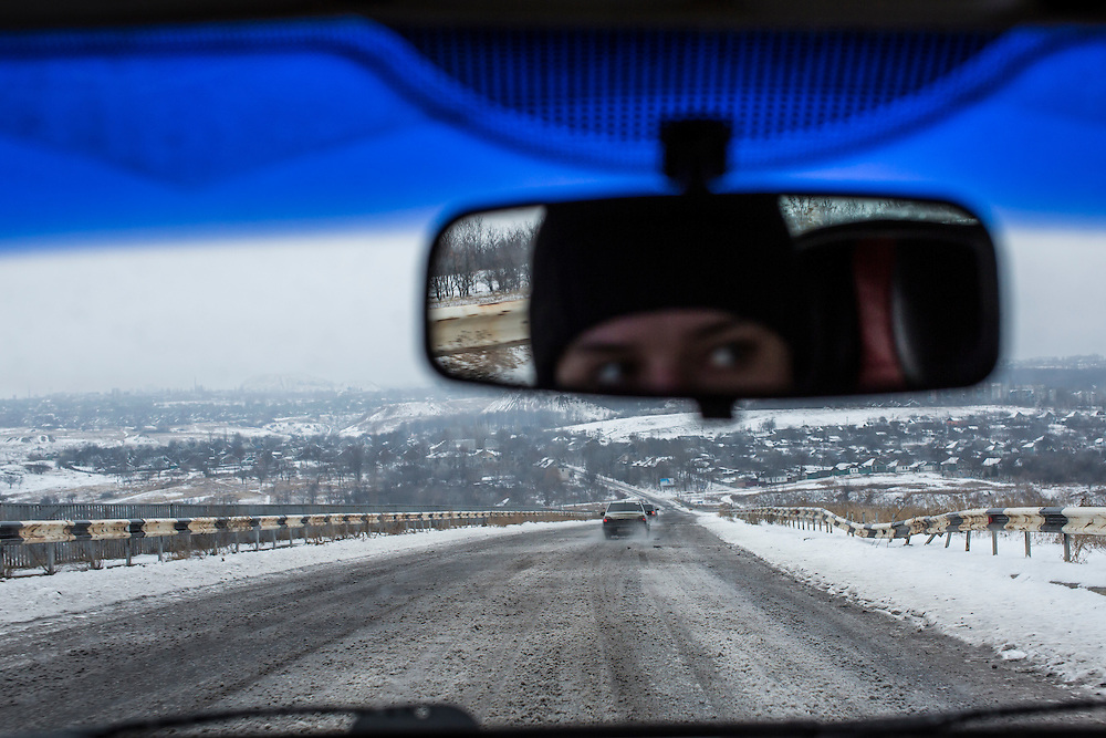 PERVOMAISK, UKRAINE - DECEMBER 8, 2014: The eyes of driver Maksim Kalmykov and a view of the road approaching Pervomaiske, Ukraine. CREDIT: Brendan Hoffman for The New York Times