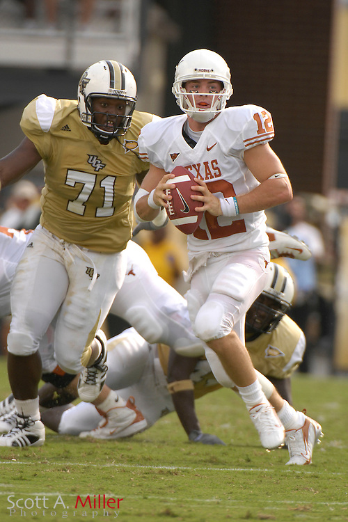 Sep 15, 2007; Orlando, FL, USA; Texas Longhorns quarterback (12) Colt McCoy is chased by Central Florida  Knights defender (71) Emeka Oakammor during the first half at Bright House Stadium. ...©2007 Scott A. Miller