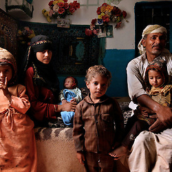 "Fatima sits with her husband and four children in Hajjah, Yemen, July 28, 2010. It is unclear what age she is now, but Fatima says she was married around the age of 8 and started having children right after her menstruation. She has had two children die during pregnancy and guesses she is now about 22 years old. ""What has happened to me is horrible. People should at least let young girls wait until their first period,"" she said."