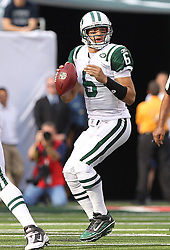 Sept 19, 2011; East Rutherford, NJ, USA; New York Jets quarterback Mark Sanchez (6) drops back to pass during the 1st half of their game against the New England Patriots at the New Meadowlands Stadium.