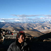 A man stands at a viewing point on a remote pass in route to Mt. Everest, part of the Himalayan mountain range, in Tibet, in western China. (Photo/Scott Dalton)