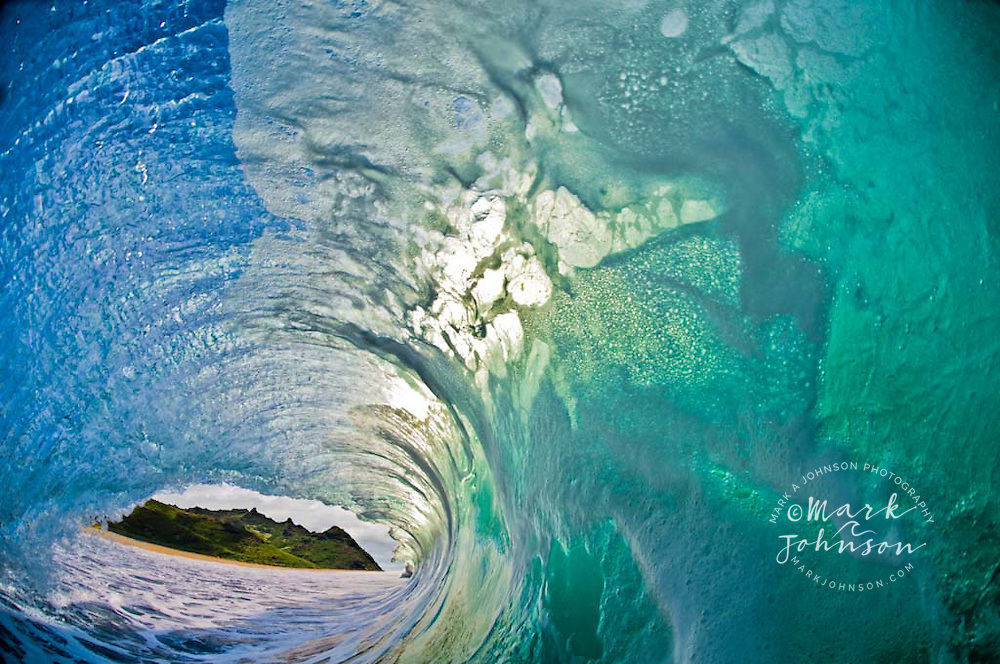 A tropical mountain range seen from inside a very hollow wave