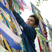 People participate in Prepare New York's Ribbons of Hope public art project on the tenth anniversary of the 9-11 terrorist attacks in Battery Park in New York City on September 11, 2011. Ribbons inscribed with personal messages were tied to display panels which stood in the Park over the weekend. <br />