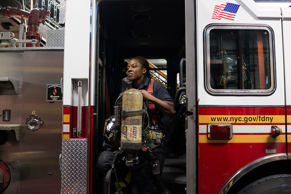 Firefighter Melissa Bennett checks the rig's equipment at the quarters of Engine 257 after a run, 1361 Rockaway Parkway, Brooklyn, NY on Tuesday, Oct. 6, 2015.<br /> <br /> Andrew Hinderaker for The Wall Street Journal<br /> NYFDNY