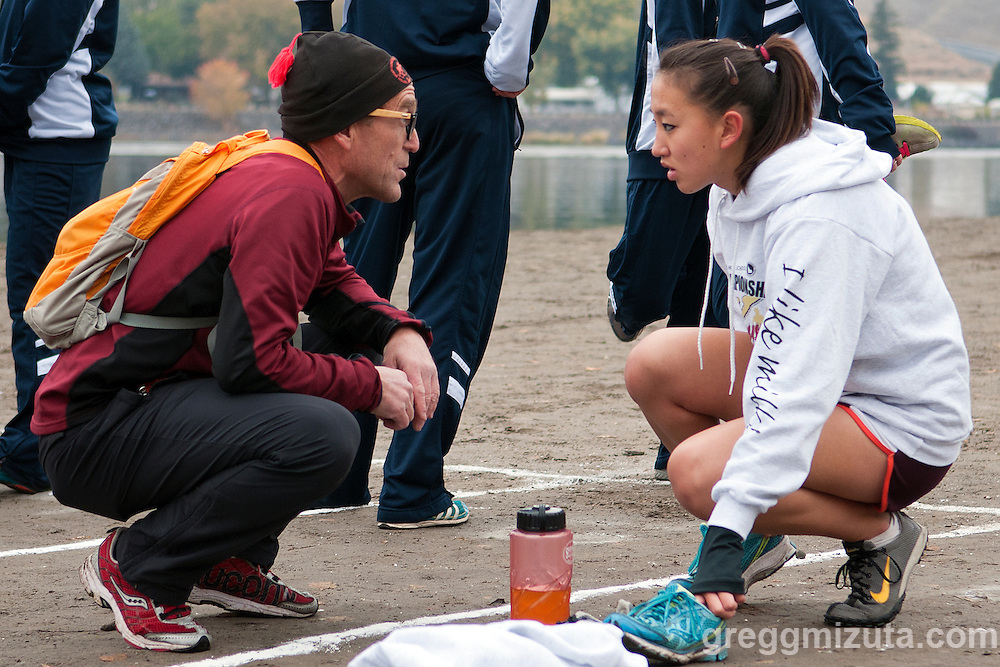 Teton coach Neil Gleichman talks with Tian Harr before the start of the Idaho High School Cross Country State 3A Championships on October 27, 2012 at Hells Gate State Park in Lewiston, Idaho. Harr completed the 5k course in  21:44.90 and was the fourth Teton finisher, helping the team to third place (94) behind Sugar-Salem (39) and Snake River (85).