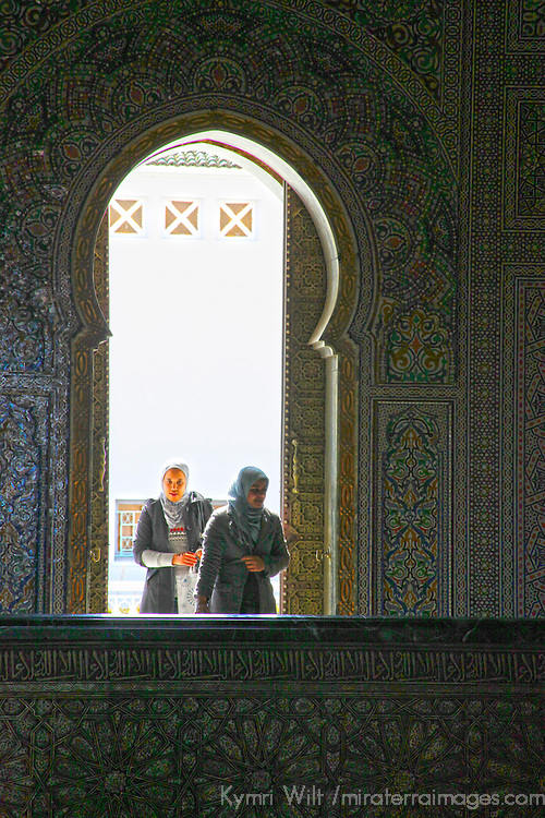 Africa, Morocco, Rabat. Women entering Mausoleum of Mohammed V.