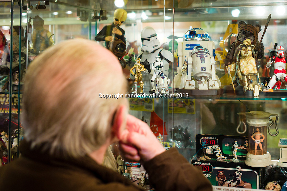 Brussels 8th december 2013 Utopia is a famous comics shop in Brussels rue de midi. They also sell collectible toys, science-fiction, novels.Man looking at star wars items