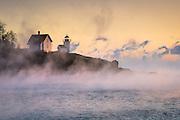 Sea Smoke billows around Curtis Island Lighthouse on a frigid morning in December.