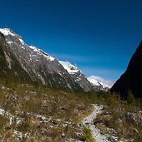 The gravel pathway of the Milford Track, Fiordland, New Zealand as it passes through the glacial valley of Clinton Canyon