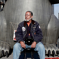 Richard W. is from Local 46 Iron Workers and has worked construction for over 40 years. He's sitting in front of a giant inflatable rat that unions display at protest sites in NYC metro.  He's here to reminded the non-union workers at a construction site that the unions fought hard for the good jobs that they are now benefiting from.