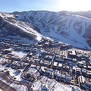 SHOT 3/2/17 4:37:32 PM - Aerial photos of Park City, Utah. Park City lies east of Salt Lake City in the western state of Utah. Framed by the craggy Wasatch Range, it's bordered by the Deer Valley Resort and the huge Park City Mountain Resort, both known for their ski slopes. Utah Olympic Park, to the north, hosted the 2002 Winter Olympics and is now predominantly a training facility. In town, Main Street is lined with buildings built primarily during a 19th-century silver mining boom that have become numerous restaurants, bars and shops. (Photo by Marc Piscotty / © 2017)