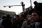 Egyptian protesters take part in a mass protest against military rule November 22, 2011 in Tahrir square in central Cairo, Egypt. Thousands of protestors demanding the military cede power to a civilian government authority clashed with Egyptian security forces for a fourth straight day in Cairo, with hundreds injured and at least 29 protestors killed so far.  (Photo by Scott Nelson)