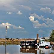 LA SALLE, CO - SEPTEMBER 14: A dump truck sits in standing flood water from the South Platte River as heavy rains for the better part of week fueled widespread flooding in La Salle, Colorado on September 14, 2013. (Photo by Marc Piscotty/ © 2013)