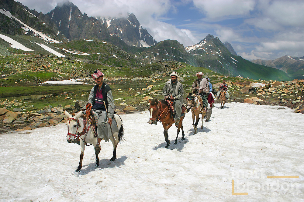 """Bakarwal Gujjar mean ride their ponies to work. These men are """"pony wallahs"""" or porters for the Amarnath Yatra in Kashmir, India every year. Sonamarg, Kashmir, India"""