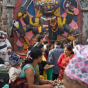 """This 12 foot high stone image of Kala Bhairava, a diety important to the Newars, was sculpted in the 17th century, in Durbar Square (or Hanuman Dhoka), in Kathmandu, Nepal. Shiva appears as Bhairab in his terrifying mode. Bhairab can appear in 64 different ways, none of them pretty. """"Telling a lie while standing before Kala Bhairab will bring instant death."""" Kala means black, and Bhairava is Sanskrit for """"Terrible"""" or """"Frightful"""" (also known as Kala Bhairab, Bhairava, Bhairo, Bhairon or Bhairadya). Published in Silkroad inflight magazine for Dragonair September 2013 issue by Bauer Media Hong Kong."""