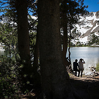 Hiking the Crystal Lake Trail out of the Mammoth Lakes basin. The hike provides vistas of Lake Mary, Lake George as well as the destination lake, Crystal Lake. A strong winter snowfall will leave snow on the side of the trail through June and provide a picturesque backdrop once you reach Crystal Lake.