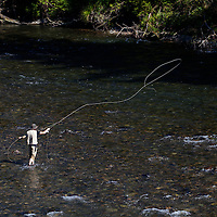 WA09141-00...WASHINGTON - Fly fishing on the Middle Fork of the Snoqualme River near North Bend. (MR# J9)
