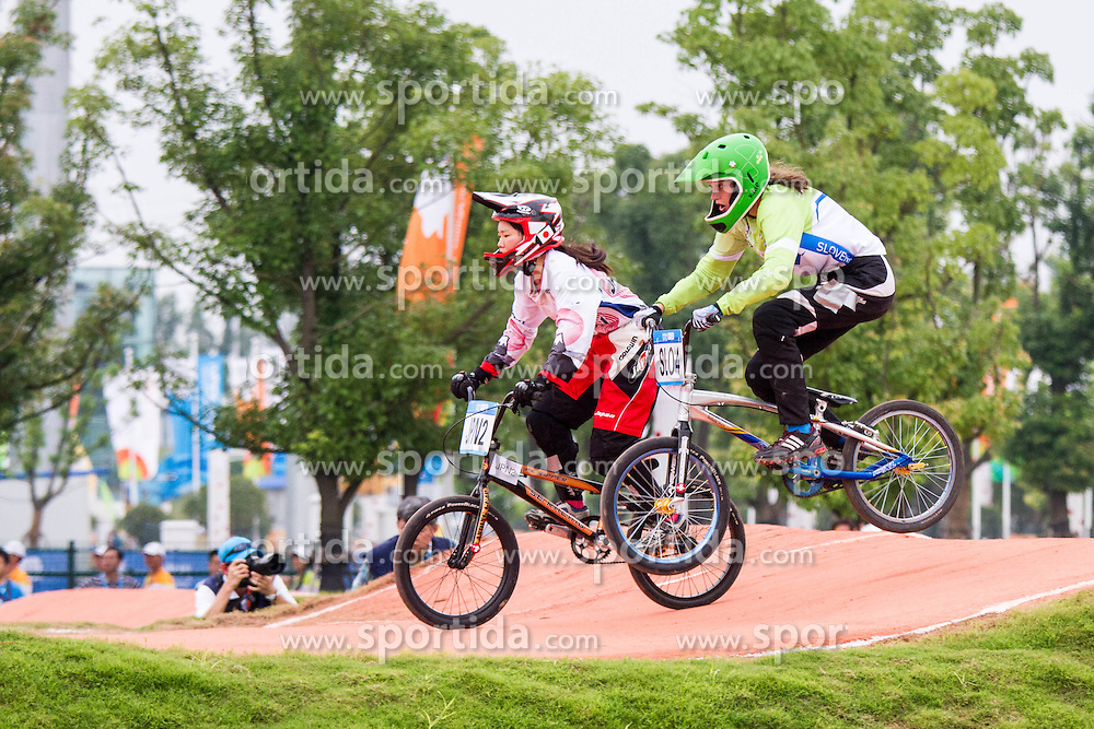 Katja Jeretina at BMX competition at 2nd Youth Olympic Games in Nanjing, China. Photo by: Peter Kastelic/Sportida