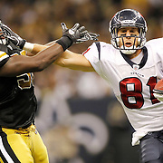 September 25, 2011; New Orleans, LA, USA; Houston Texans tight end Owen Daniels (81) fights off New Orleans Saints linebacker Jo-Lonn Dunbar (56) during the fourth quarter at the Louisiana Superdome. New Orleans defeated Houston 40-33. Mandatory Credit: Crystal LoGiudice-US PRESSWIRE