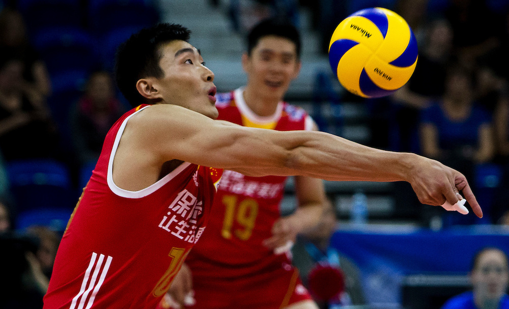 Daoshuai Ji of China returns the ball versus Portugal at a World League Volleyball match at the Sasktel Centre in Saskatoon, Saskatchewan Canada on June 24, 2016