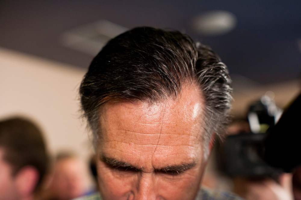 Republican presidential candidate Mitt Romney meets with voters at the Family Table restaurant on Saturday, December 31, 2011 in Le Mars, IA.