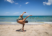 A dancer/poser shows his skills at Palm Beach. FLA