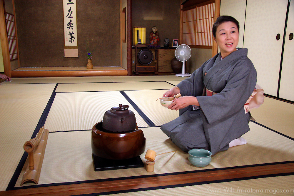 Asia, Japan, Kyoto. Hostess prepares to serve tea.