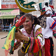 A Thai woman dances during festivities at Thailand's Phi Ta Khon Ghost festival Friday, June, 22nd, 2012, in Dan Sai, Thailand.  The Dan Sai Ghost Festival is unique to the Isan area of Thailand in the east and is part of local beliefs in spirits and ghost and is also a Buddhist merit making festival.  The ghost masks are made from bamboo sticky rice cookers and the costumes usually strips of cloth sewn together.  The origins of the Phi Ta Khon Festival are said to come from Buddha's last great incarnation before attaining Enlightenment.
