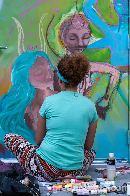Morgan Mae Cleverly works on her mural in the evening of August 11, 2016 during the Freak Alley Gallery sixth annual mural event in downtown Boise, Idaho.<br /> <br /> Freak Alley Gallery's week long event provided an &quot;art-in-motion&quot; experience as it welcomed the public to watch artists work on their murals.