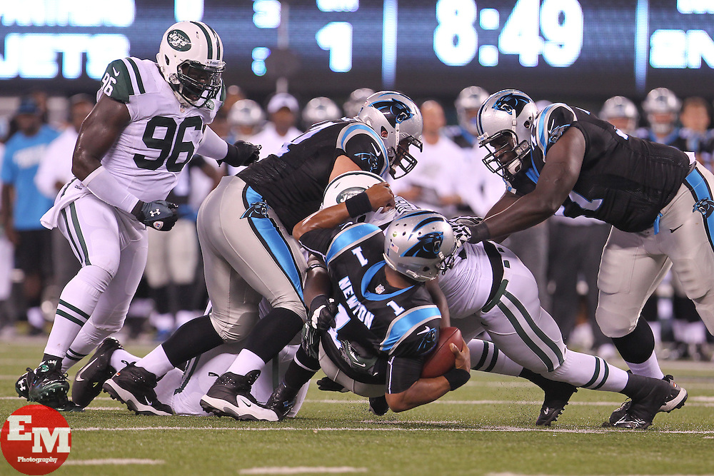 Aug 26, 2012; East Rutherford, NJ, USA; Carolina Panthers quarterback Cam Newton (1) is sacked by New York Jets defensive end Jay Richardson (92) during the first half at MetLife Stadium.