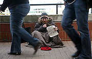 A homeless man hopes to get some money, South Bank, London.