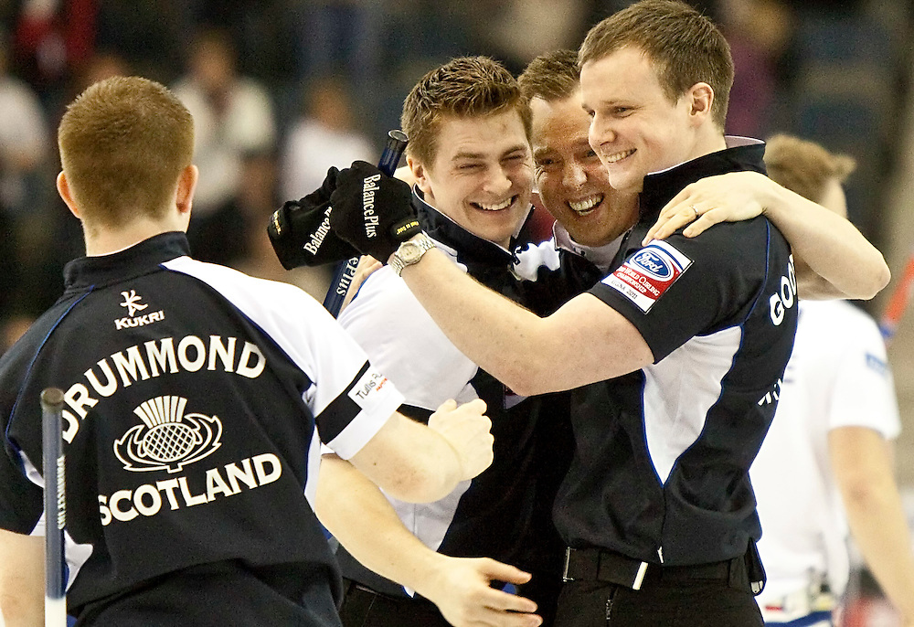 The Scottish team celebrate 7-6 win in their semi-final against Norway at the Ford World Men's Curling Championships in Regina, Saskatchewan, April 9, 2011. The Scottish team, from left, Greg Drummond, Scott Andrews, skip Tom Brewster and Michael Goodfellow, will face Canada in the final Sunday.<br /> AFP PHOTO/Geoff Robins