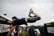 The beer-fueled running of the urinals continued in 2008 at Pimlico Race Course in Baltimore even though preventative measures were taken in the Preakness Day infield. A urinal runner tries to make a leap from one row of portable johns to another — and fails as he falls short. He hit the side of the unit and crumpled as he hit the ground head first. He was conscious when taken away, ending his day in the infield before the 133rd Preakness at Pimlico. The gap was supposed to stop the runners.