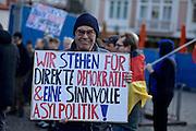 Frankfurt am Main | 30 Mar 2015<br /> <br /> Am Montag (30.03.2015) demonstrierten etwa 40 Menschen unter dem Namen &quot;Freie B&uuml;rger f&uuml;r Deutschland&quot; auf dem R&ouml;merberg in Frankfurt am Main gegen Islamisierung und zahlreiche andere &Uuml;bel, die Gruppe war zuvor unter dem Namen &quot;PEGIDA&quot; aufgetreten. Etwa 600 Menschen protestierten lautstark gegen diese Kundgebung.<br /> Hier: &quot;Freie B&uuml;rger f&uuml;r Deutschland&quot;-Demonstrant mit einem Plakat mit der Aufschrift &quot;Wir stehen f&uuml;r direkte Demokratie &amp; eine sinnvolle Asylpolitik&quot;.<br /> <br /> &copy;peter-juelich.com<br /> <br /> [No Model Release | No Property Release]