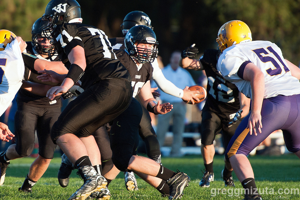 Wyatt Currey and Nic Fugate bock for Zac Jacobs as Burns's Kaleb Nyborg moves in for a tackle. Vale - Burns football game, September 18, 2015 at Vale High School, Vale, Oregon. Vale won 65-28.