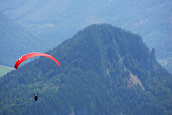 Paragliders in the air above the town of Altaussee, with the Altausseer See down below. Covering the Red Bull X Alps race 2007, Austria.