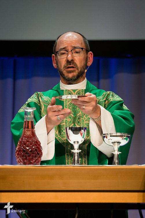 The Rev. Peter C. Bender, pastor of Peace Lutheran Church in Sussex, Wis., speaks the Words of Institution at the Opening Divine Service of the 66th Regular Convention of The Lutheran Church–Missouri Synod on Saturday, July 9, 2016, at the Wisconsin Center in Milwaukee.  LCMS/Michael Schuermann