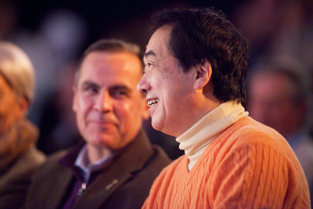 Japan's Minister of Finance Naoto Kan, right watches an Inuit performance as Bank of Canada Governor Mark Carney looks on during a ceremony at the G7 Finance Ministers meeting In Iqaluit, Canada, February, 5, 2010.<br /> AFP/GEOFF ROBINS/STR
