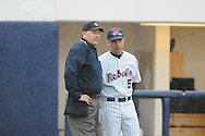 Ole Miss Head Coach Mike Bianco (5) talks to home plate umpire against Arkansas State at Oxford University Stadium in Oxford, Miss. on Wednesday, February 23, 2011.