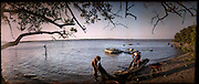 "Fishermen from the town of Pueblo Viejo de San Dionisio prepare their nets before heading out to fish...The Isthmus of Tehuantapec, long a center for indigenous land ownership, is now embroiled in a land dispute over wind farm land...Called ""Mexico's little waist,"" the Isthmus is a wind tunnel that links the Gulf of Mexico to the Pacific through mountain passes at the narrowest part of Mexico. The geographical funnel makes it one of the windiest places in North America and for a decade wind energy companies have been jostling to acquire land to power the likes of Coca-Cola and Wal Mart."