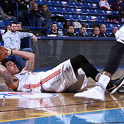 Delaware 87ers Forward Drew Gordon (32) seen attempting to past the ball while laying on his back in the first half of a NBA D-league regular season basketball game between the Delaware 87ers and the Erie BayHawk (Orlando Magic) Friday, Mar. 20, 2015 at The Bob Carpenter Sports Convocation Center in Newark, DEL.