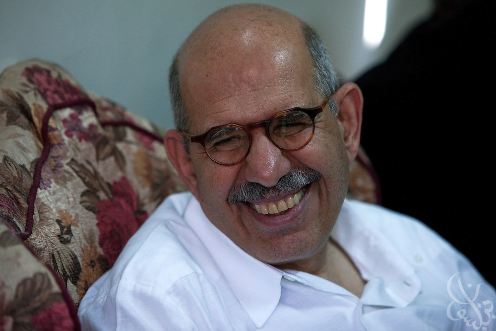Egyptian Nobel Peace laureate and former UN atomic watchdog chief, Mohamed ElBaradei smiles while talking with supporters in the Egyptian Nile delta town of Aga April 2, 2010. ElBaradei is thought to be a possible candidate to run against Egyptian President Hosni Mubarak in the 2011 presidential election, although he has not made a formal declaration as of yet.