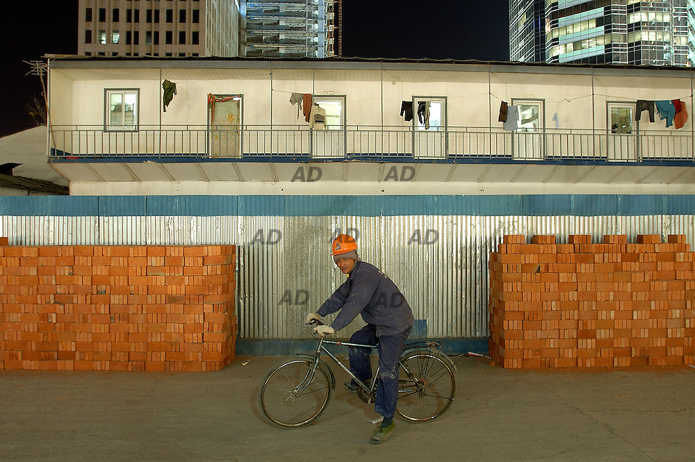 Yards in the Central Business District. A migrant worker.