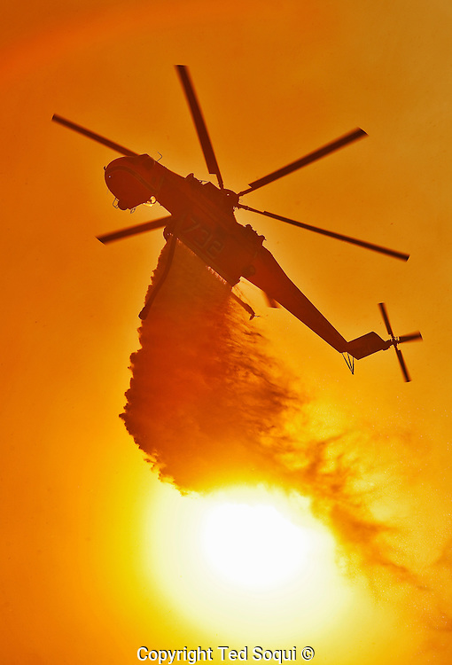 9000 acre Guiberson wildfire burns out of control near the city of Fillmore, CA. The fire was fed by Santa Ana winds, triple digit temperatures, and single digit humidity levels. Most of the fire burned in rural canyon areas and was started by a manure combustion fire.