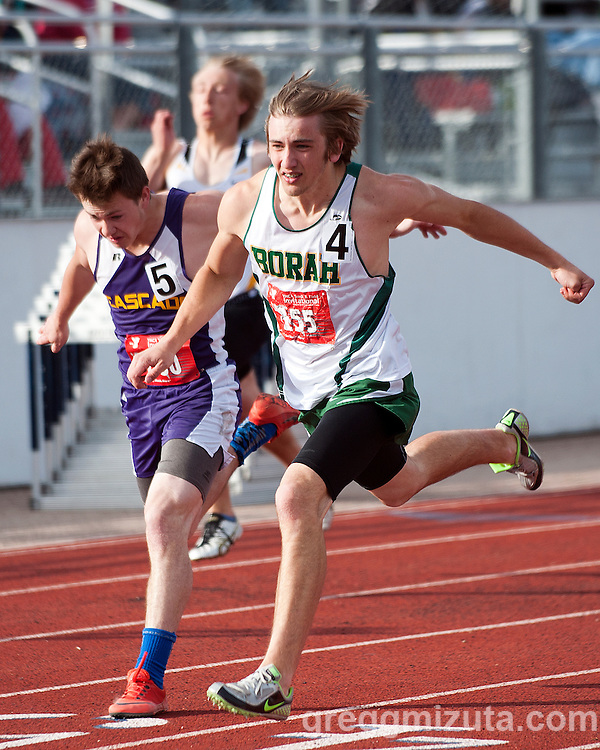 Borah senior Wes Loertscher edges Cascade junior Sam Benzie,to wins heat 6 of the YMCA Track & Field Invitational 100 meter preliminaries at Mountain View High School, Meridian, Idaho. April 24, 2015. Loertscher winning time (11.47a) qualified him as the sixth seed for the finals.