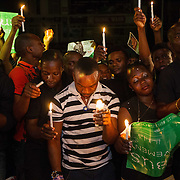 Ogoni youth observe a moment of silence during a vigil in Port Harcourt, Niger delta, marking 20 years since the Nigerian military government executed human rights activist Ken Saro-Wiwa and eight other Ogoni leaders. Jesse Winter Photo.