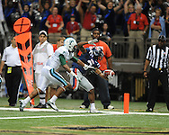 Ole Miss running back Jeff Scott (3) scores vs. Tulane's Lorenzo Doss (6) in the first half at the Mercedes-Benz Superdone in New Orleans, La. on Saturday, September 22, 2012. Ole Miss won 39-0...