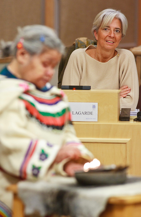 France's Minister of the Economy, Industry and Employment, Christine Lagarde watches as an Inuit elder performs a ceremony at the start of talks at the G7 Finance Ministers Meeting, February 6, 2010, in Iqaluit, Canada.<br /> AFP/GEOFF ROBINS/STR